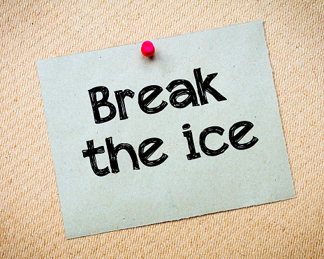 Break the ice Message. Recycled paper note pinned on cork board. Concept Image